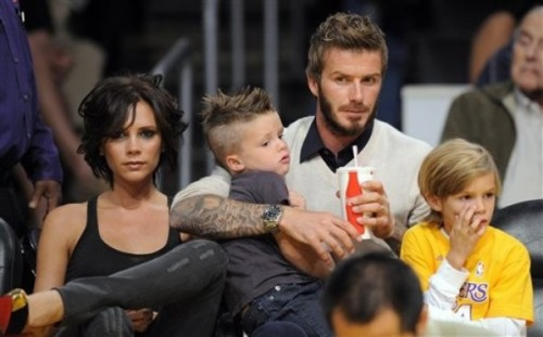 Victoria Beckham and David Beckham with their children