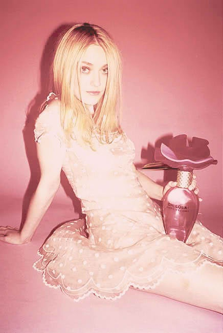 "Dakota Fanning's new perfume ad — "" Oh Lola ! "" gets banned in Britain."