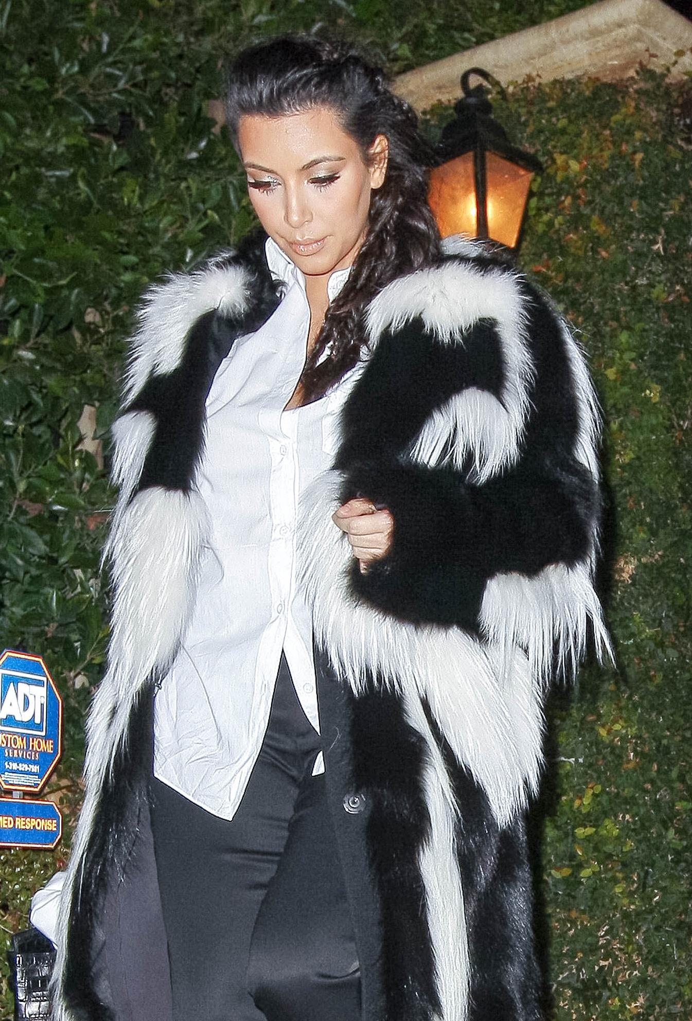 Exclusive - Expectant Mom Kim Kardashian Debuts Baby Bump in Skunk Fur Coat With Proud Dad-To-Be Kanye West