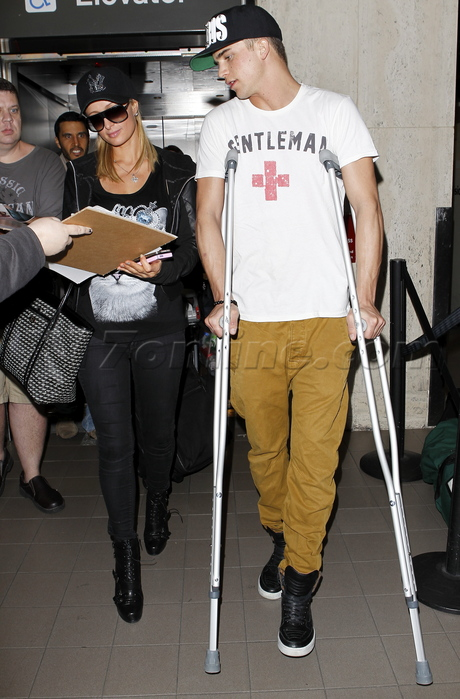 Paris Hilton at LAX with River Viiperi on crutches