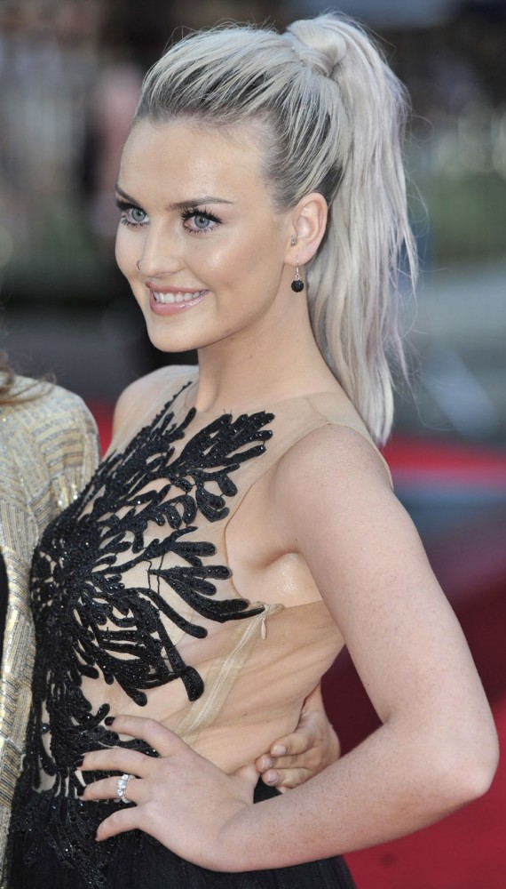 "Perrie Edwards shows off her ring at the ""This Is Us"" premiere. (WENN)"