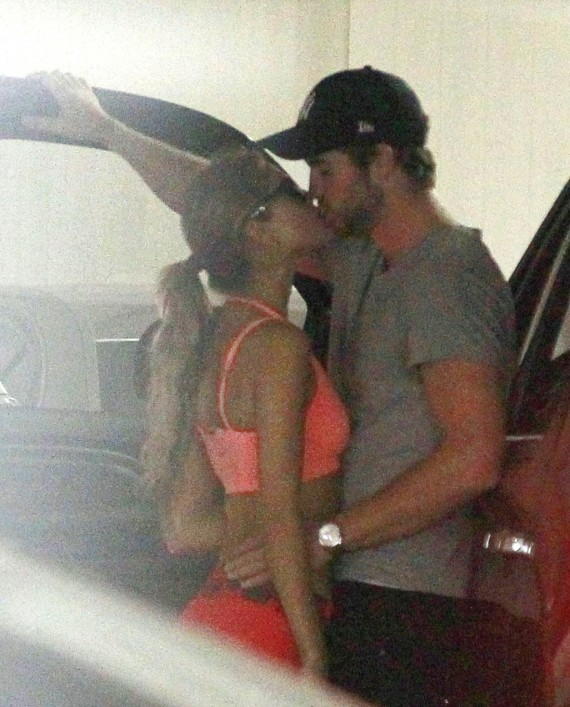 Liam Hemsworth likes his kisses well documented, apparently. (Pacific Coast News)