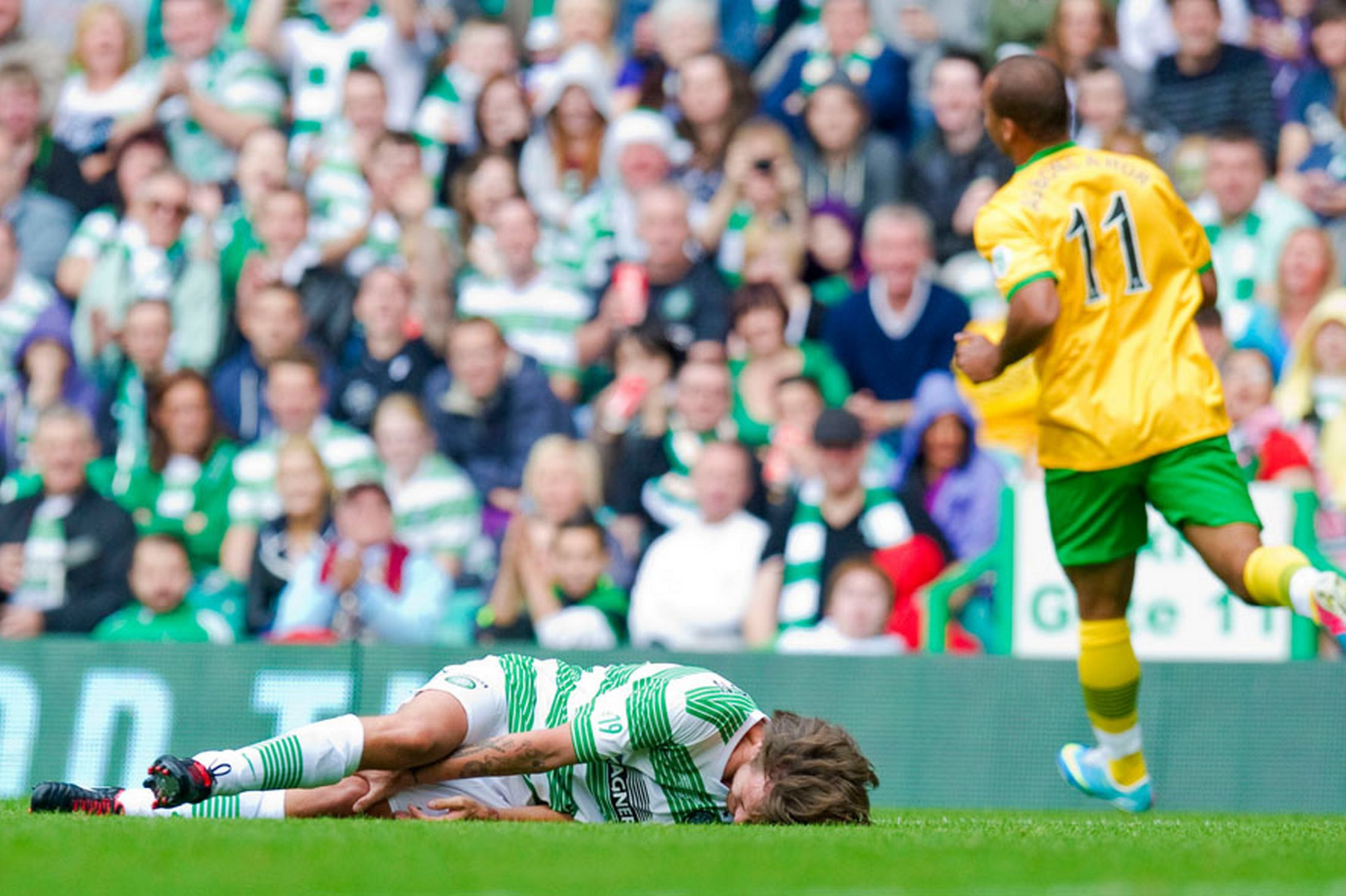 Featured image for Poor Baby: Louis Tomlinson Gets Tackled and Vomits! [PHOTOS]