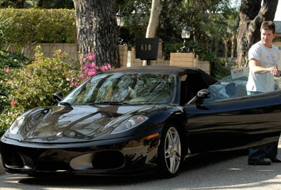 Simon-Cowell-Driving-His-Ferrari-F430