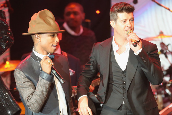 Pharrell Williams and Robin Thicke perform together