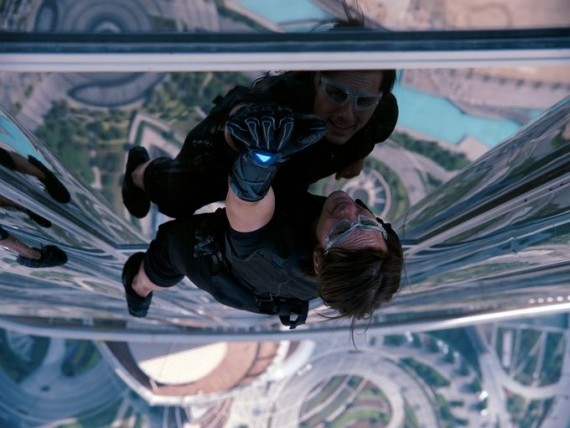 Tom Cruise climbing a building