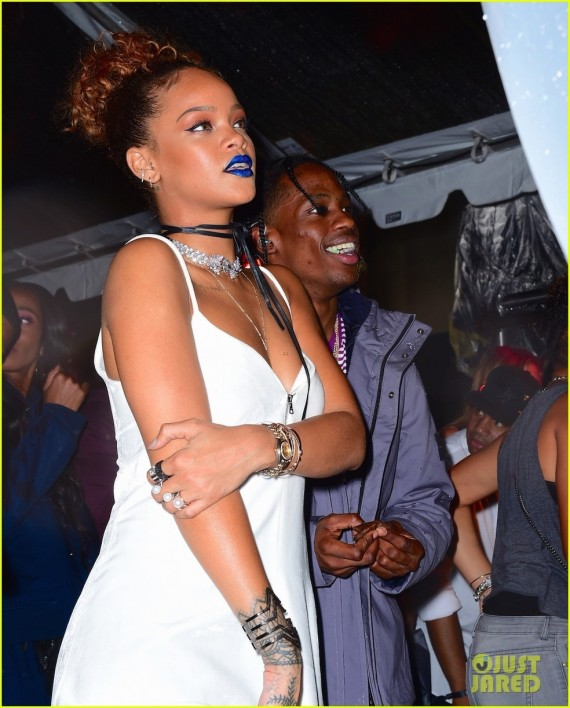 Rihanna and her rumored boyfriend Travis Scott did nothing to dispel dating rumors. The pair cozied up at Rihanna's Roc Nation Block Party, before Travis took the stage in the pouring rain. They whispered into each other's ears and laughing uncontrollably. She cheered wildly while Travis performed 4 of his hit songs. Pictured: Rihanna, Travis Scott Ref: SPL1122209 100915 Picture by: 247PAPS.TV / Splash News Splash News and Pictures Los Angeles: 310-821-2666 New York: 212-619-2666 London: 870-934-2666 photodesk@splashnews.com